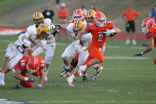 Braden Hucks breaks through the defense of Menlo (California) in a 2013 game at San Angelo Stadium.