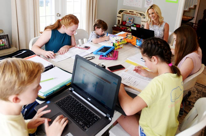 Cathlean Snyder is a Caddo Parish school teacher who teaches classes online as well as teaching her five children during the coronavirus Friday afternoon, April 3, 2020.