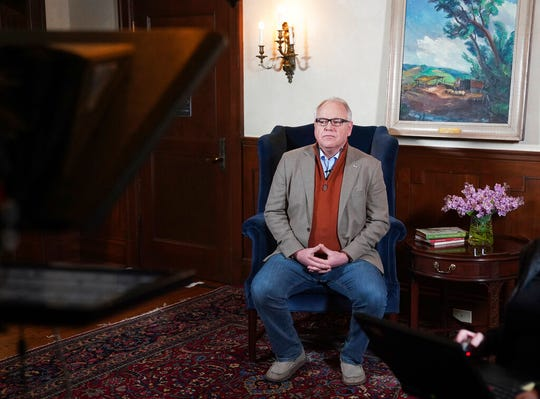 Minnesota Gov. Tim Walz prepares to deliver his delayed State of the State address over YouTube from his residence in St. Paul, Minn., Sunday, April 5, 2020.