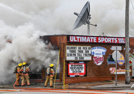 Firefighters battle a blaze at the Ultimate Sports Bar & Grill Monday, April 6, 2020, in Waite Park.