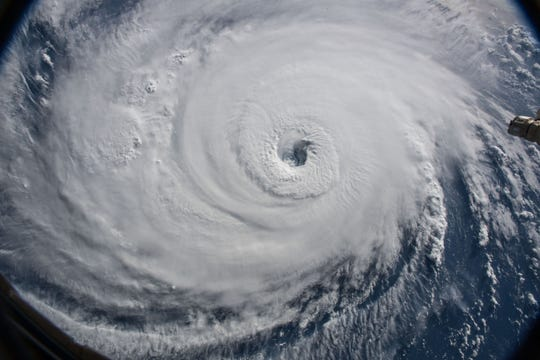 Hurricane Florence is seen in the Atlantic Ocean from the International Space Station, Wednesday, Sept. 12, 2018.