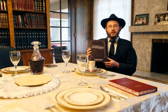 Rabbi Levi Greenberg, Chabad Lubavitch, shows how to set up a table for Seder on Monday, April 6, 2020, at his family's home in El Paso. He is showing people how they can have Seder at their homes in spite of COVID-19.