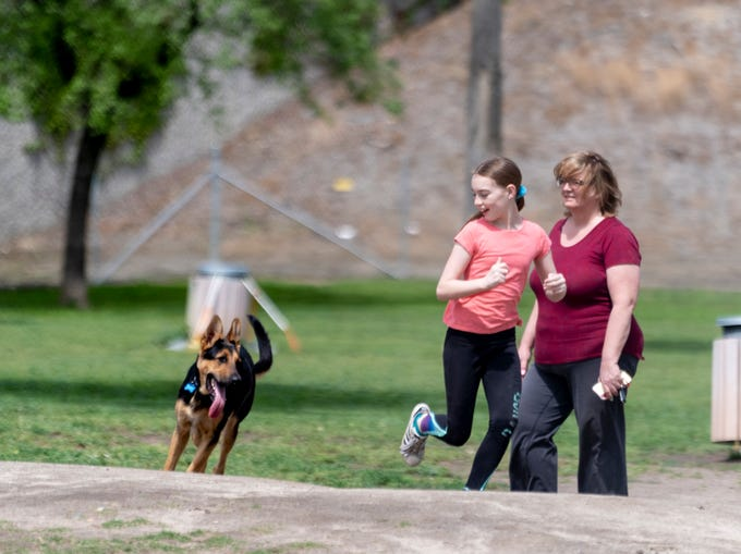 Barbara Shy, right, and her daughter Hollie Shy, 11, play with Luke and their other two dogs at Cody Kelly Bark Park on Monday, April 6, 2020.