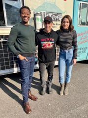 "Gene Christian Baca, center, co-owner of Walter's Hot Dogs, with actors Brandon Micheal Hall,left, and Violett Beane on the set of ""God Friended Me."""