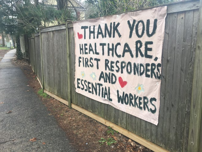 A sign thanking workers and first responders hangs from a fence on Broadway in Hastings-on-Hudson, New York on April 3, 2020 during a slowdown brought on by the coronavirus outbreak.