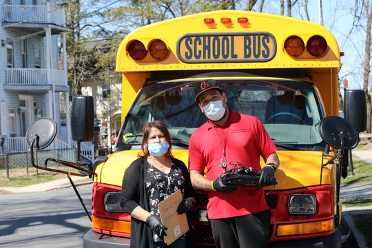 Iris Rosado and Will Cabrera, bus drivers with the Union Free School District of the Tarrytowns, delivering laptops to students that need them to do their coursework during the coronavirus pandemic April 6, 2020 in Sleepy Hollow, New York.