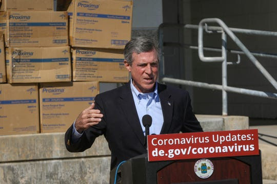Gov. John Carney announces the arrival of more personal protective equipment for paramedics in New Castle County in front of boxes of supplies on Monday, April 6.