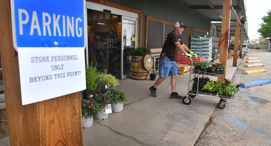 Smith's Gardentown's store is closed to the public but the business is offering curbside pickup and delivery of everything they sell.