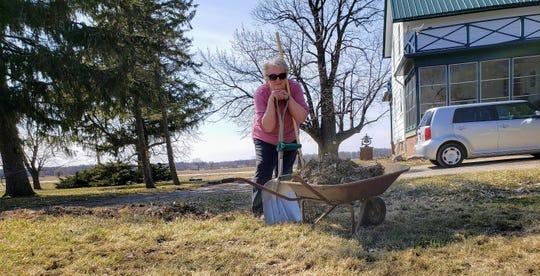 Susan taking a break from yard work.