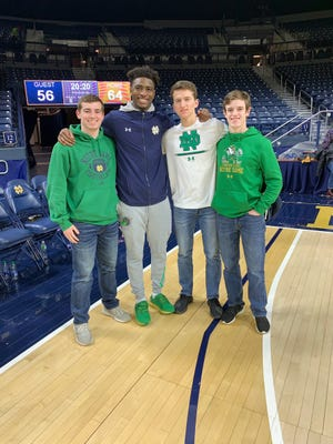 Rosecrans seniors Will Bernath (left), Jack Goggin and Cameron Hagy (right) are pictured with Notre Dame basketball player T.J. Gibbs. All three were accepted and will attend the University of Notre Dame.