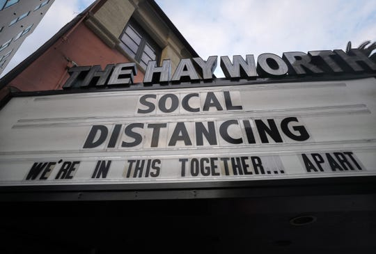 The shuttered Hayworth Theatre displays the message 'Social Distancing We're In This Together...Apart' on the marquee, as the coronavirus pandemic continues, on March 23, 2020 in Los Angeles, California. Governor Gavin Newsom issued a stay at home order for Californias 40 million residents in order to slow the spread of COVID-19.