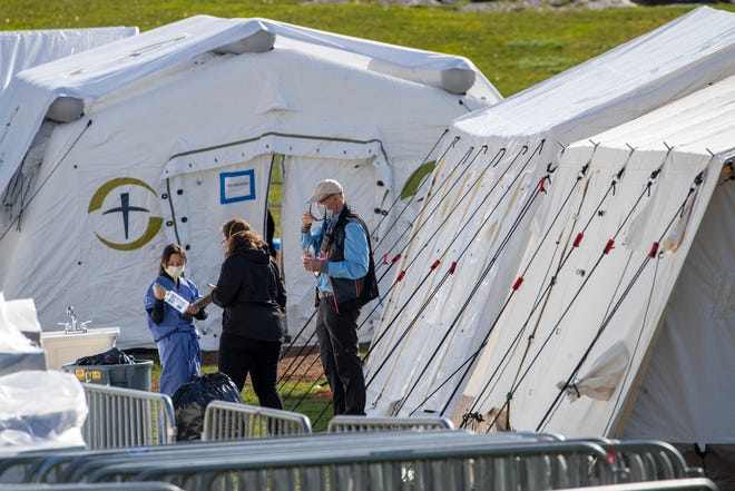 Medical personnel work at the Samaritan's Purse field hospital in New York's Central Park, Wednesday, April 1, 2020.