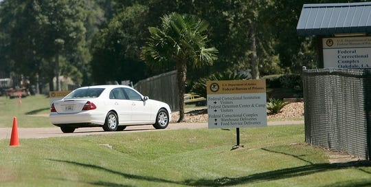 In this Sept. 26, 2006, file photo, a person drives through the gates of a federal prison in Oakdale, La.