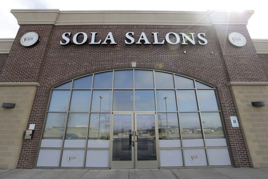 Sola Salon Studios are closed to comply with Gov. Tony Evers' safer-at-home order to mitigate the spread of the coronavirus.