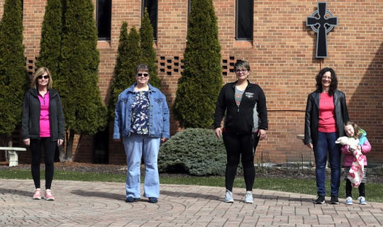 Family Recovery Journey members, from left, Kathy, counselor Carmen Collier, Amanda Gerondale and Paula Jolly stand outside Calvary Lutheran Church on Monday. The group typically meets at the church, but has started to meet virtually as a result of the coronavirus pandemic.