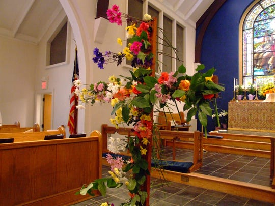 Trinity Episcopal Church in Red Bank bedecks its cross with flowers for Easter. The cross will be displayed outside this year, due to the corona pandemic.