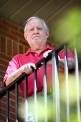 Peter Landis poses on the balcony of his downtown Asheville apartment on April 6. 2020. Landis tested positive for COVID-19 in March and has made a full recovery. He described his symptoms as similar to a really bad flu.