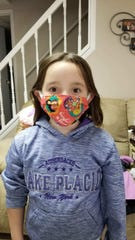 Abigail Decker, a 6-year-old first grader at Windsor's Floyd L. Bell Elementary School, has been sewing masks with her father, Brian Decker, for local health care workers.