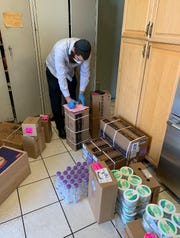 Rabbi Motty Rosenfeld looks over Passover supplies to be distributed across the Space Coast.