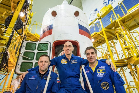 At the Baikonur Cosmodrome in Kazakhstan, Expedition 63 crew members Ivan Vagner (left) and Anatoly Ivanishin (center) of Roscosmos and NASA astronaut Chris Cassidy (right) pose for pictures April 3, 2020 in front of their Soyuz spacecraft as part of their prelaunch activities. They will launch April 9, 2020 on the Soyuz MS-16 spacecraft from Baikonur on April 9 for a six-and-a-half-month mission on the International Space Station.