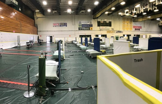 Cots, partitions and oxygen are arranged inside UVM's Patrick Gymnasium as part of a conversion of the space into a 50-bed overflow facility for COVID-19 patients from UVM Medical Center on April 7, 2020.