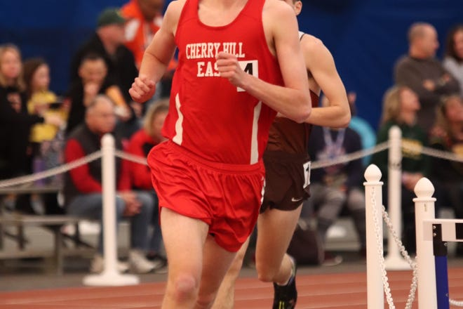 Cherry Hill East senior Oliver Adler runs during a winter track meet. He captured the Group 4 state championship in the 3,200 meters in February.