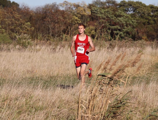 Cherry Hill East senior Oliver Adler runs during a cross country meet. He finished fifth at the Meet of Champions last fall.
