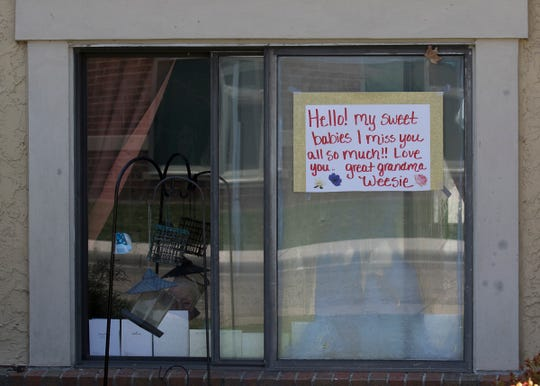 """A sign hangs inside the room of a resident at Westmoreland. A """"Honk for Hugs"""" parade was organized to remind the residents of Westmoreland that their families and friends had not forgotten about them during their seclusion caused by the coronavirus epidemic since those of advanced age are more susceptible to the deadly virus on April 6, 2020."""