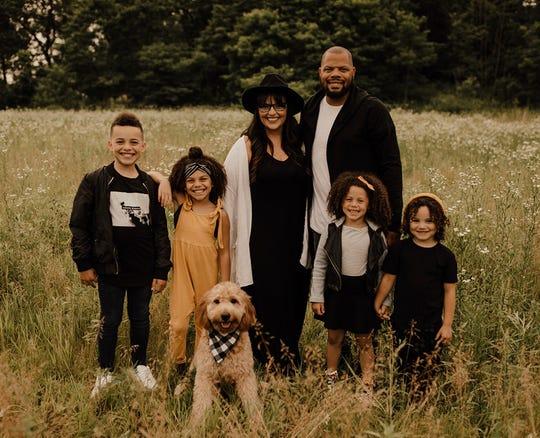 LaMorris Crawford, his wife Megan, their four kids and family dog.