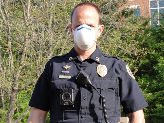 Clarksville Police Captain Chad Koyama equipped with a face mask on duty amid the COVID-19 outbreak on Monday, April 6, 2020.