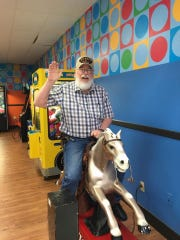 Bill Rubel shows his silly side on a mechanical horse in an undated photo. On Friday, April 3, 2020, Rubel became the first reported Montgomery County death due to the coronavirus.
