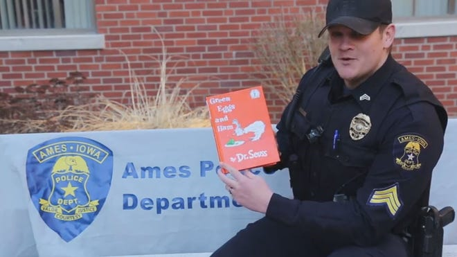 """Ames police Sgt.  Eljah Hansen reads """"Green Eggs and Ham"""" in a Facebook video."""