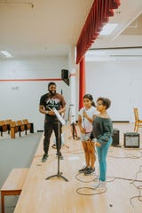 Teaching artist Juliano Dock coaches young singers at the Des Moines Music Coalition's 2019 Hip-Hop summer camp.