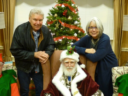 Ronald Mason annually acts as Santa Claus for celebrations at Edgewater at WesleyLife in West Des Moines. He is pictured with his son and daughter, Ronald Mason, Jr. and Linda Hunter.