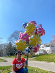 Calvetta Williams released balloons as Kaydee Bobbitt was memorialized with a vigil April 7, 2020 on 33rd Street and Kingman Boulevard, where she was fatally shot while driving with her 17-year-old daughter on April 3.