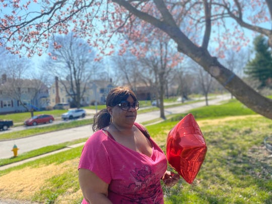 Reeva Neighbors passed out balloons to the Des Moines community as Kaydee Bobbitt was memorialized with a vigil April 7, 2020 on 33rd Street and Kingman Boulevard, where she was fatally shot while driving with her 17-year-old daughter on April 3.