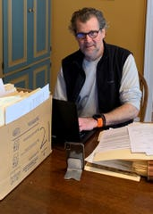 Roger Schrading is a Philadelphia-based public defender in the homicide unit who recently joined the UAW. He is among a growing trend of white-collar UAW members. He is pictured here working from home on March 27.