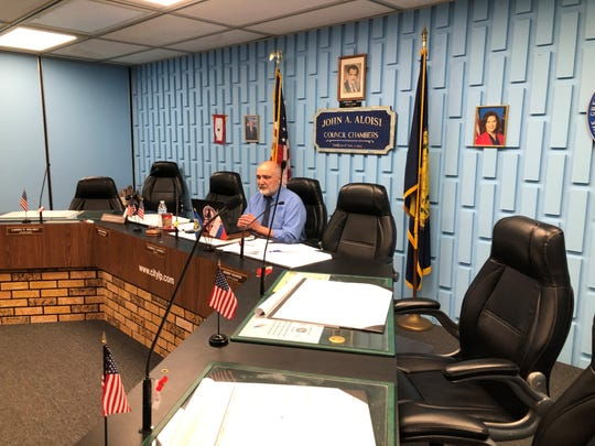 In suburban Detroit, Lincoln Park Mayor Thomas Karnes addresses other city council members via the networking program Zoom to avoid transmitting the COVID-19 virus on April 6, 2020.