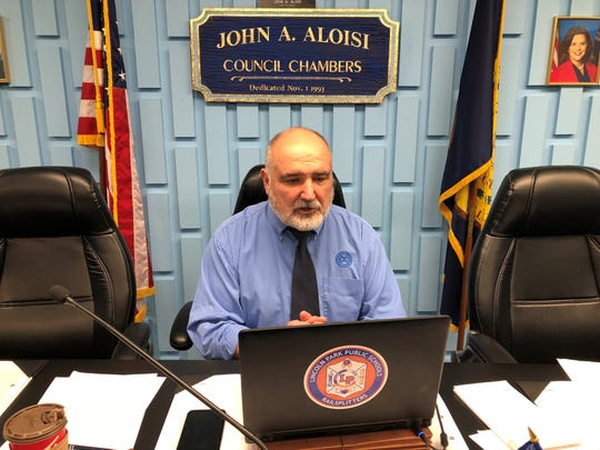Lincoln Park Mayor Thomas Karnes sits alone on the city council dais on April 6, 2020, as he chairs the city's first virtual council meeting held over the internet.
