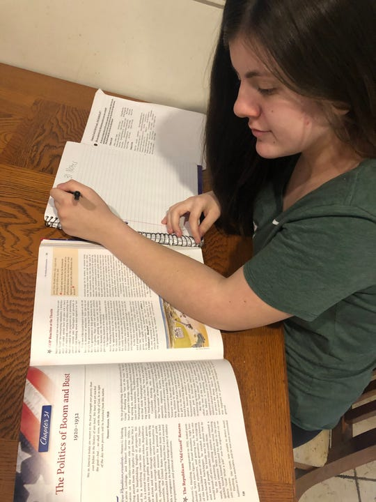 High school student Farrah Fasse studies at home for her AP class last week. Students taking AP classes will be taking AP exams online next month.