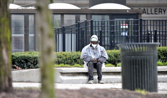 Robert Newman, 53, says he's been homeless in Detroit since 1986, with the exception of prison and treatment centers. 'They were trying to get me a place to stay until this coronavirus hit, then everything went into quarantine, says Newman,' as he sits at Grand Circus Park, Tuesday, April 7, 2020.