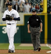 Tigers pitcher Armando Galarraga smiles as he walks away from first-base umpire Jim Joyce, who called the Indians' Jason Donald safe at first base with two outs in the ninth inning of a game June 2, 2010. Galarraga lost his bid for a perfect game with the call.