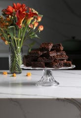 Brownies made with green banana flour are studded with cacao nibs for more chocolate flavor and for texture.