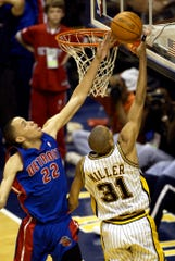 The Pistons' Tayshaun Prince (22) blocks the shot of  Pacers guard Reggie Miller (31) late in Game 2 of the 2004 Eastern Conference finals in Indianapolis.