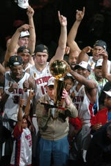 The Pistons celebrate their 2004 NBA championship after ousting the Los Angeles Lakers.