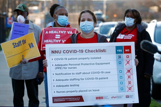 Medical and other Veterans Administration employees join registered nurses outside the Brooklyn Veterans Administration Medical Center, Monday, April 6, 2020, in New York, to call for more personal protective equipment (PPE) and staffing assistance to care for those affected by the current coronavirus outbreak.
