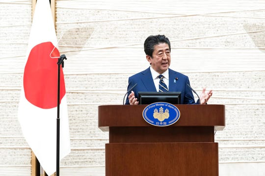 Japan's Prime Minister Shinzo Abe speaks during a press conference at the prime minister's official residence Tuesday, April 7, 2020, in Tokyo. Abe declared a state of emergency for Tokyo and six other prefectures to ramp up defenses against the spread of the coronavirus.