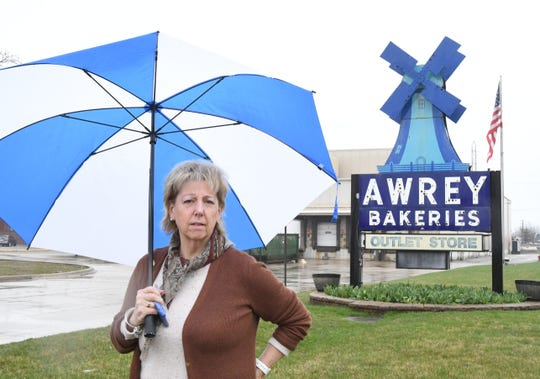 Diane Lynch, vice president of Minnie Marie Bakers, Inc, stands in front of Awrey Bakery in Livonia on April 7. With unemployment benefits and the threat of the virus keeping most people at home, the bakery is struggling to stay staffed, says owner Ronald Beebe.