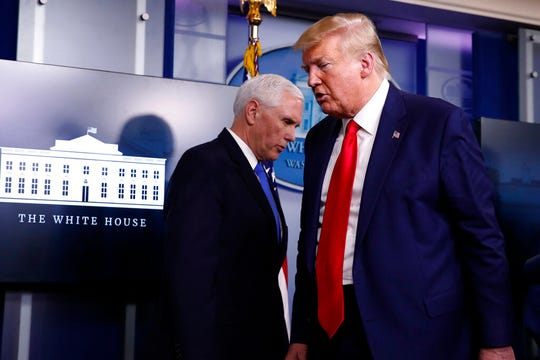 President Donald Trump turns from the podium to depart as Vice President Mike Pence steps up to speak about the coronavirus in the James Brady Press Briefing Room of the White House, Monday, April 6, 2020, in Washington.