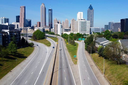 Lighter than normal traffic flow in and out downtown Atlanta Monday, April 6, 2020.